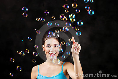 Happy girl and soap bubbles