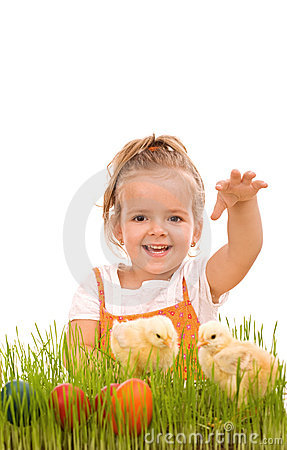 Happy girl with spring chicks and easter eggs