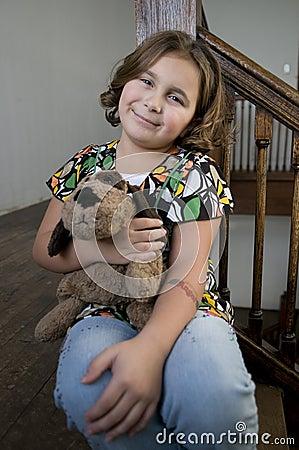 Happy girl with stuffed dog
