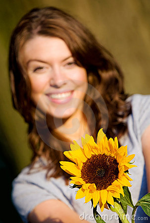 Happy girl with a sunflower