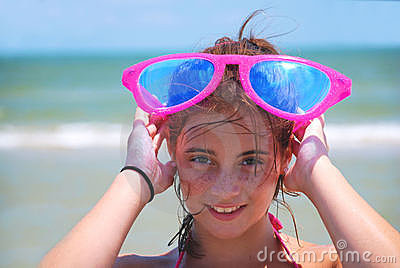 Happy Girl with Sunglasses at the Beach