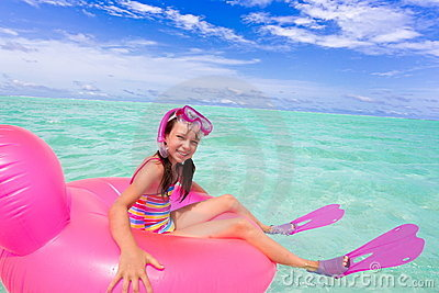 Happy girl swimming in ocean