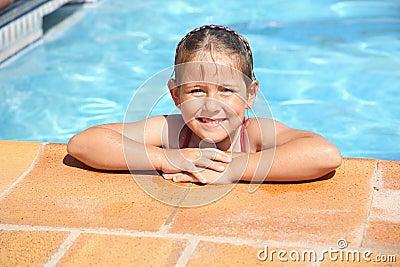 Happy girl at swimming pool