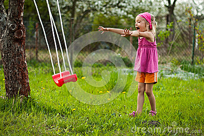 Happy girl with swing.