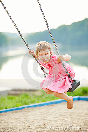 Free Happy Girl Swinging On Swing Royalty Free Stock Photos - 49071878