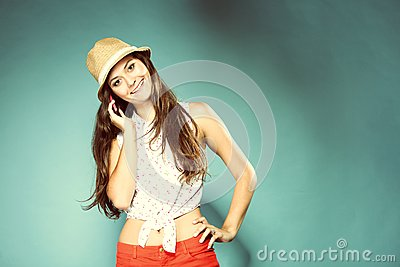 Happy girl talking mobile phone