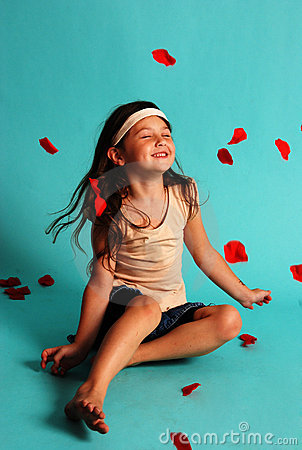 Free Happy Girl Tossing Rose Petals Stock Photos - 3240113