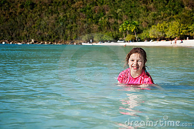 Happy girl at tropical beach