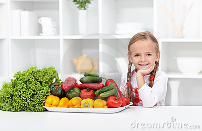 Happy girl with various vegetables