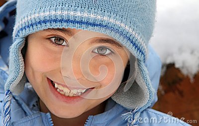Happy girl in wool hat