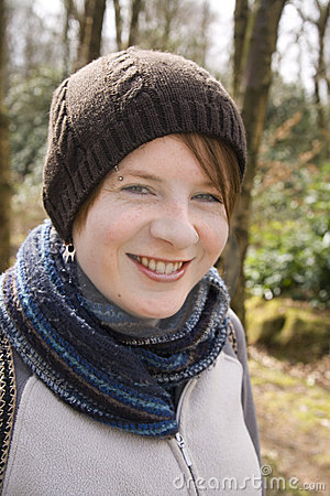 Happy Girl wrapped up in hat and scarfe
