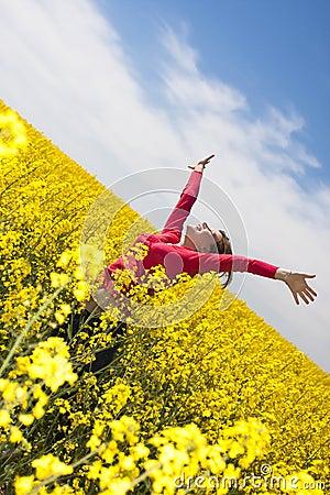 Happy girl in yellow field
