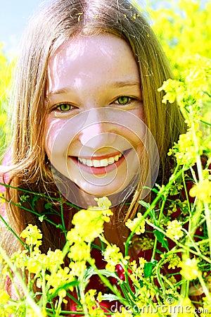 Happy girl in yellow flowers