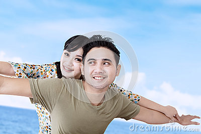 Happy girlfriend enjoy piggyback ride