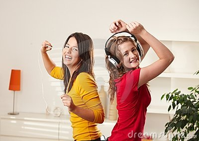 Happy girls dancing to music