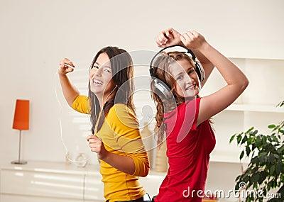 Happy girls dancing to music