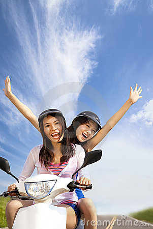 Free Happy Girls On A Scooter Royalty Free Stock Photo - 20828245