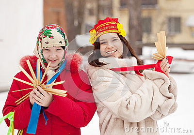 Happy girls plays during Shrovetide