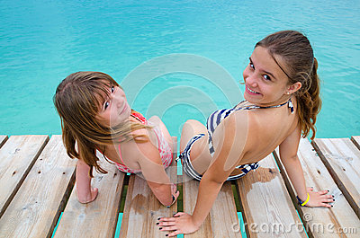 Happy girls on tropical bridge