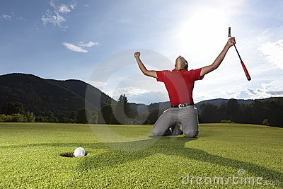 Happy golf player on geen.