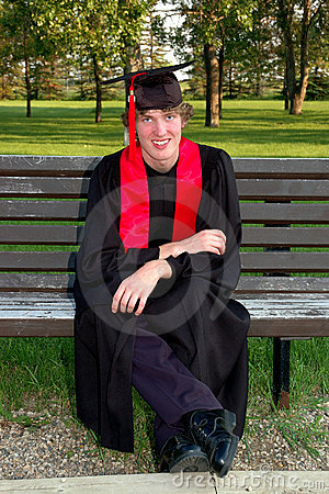 Happy Graduate in Cap and Gown