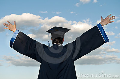Happy graduate with risen arms