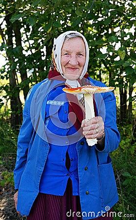 Happy grandma with a big fly agaric