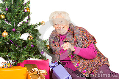 Happy grandmother preparing for Christmas