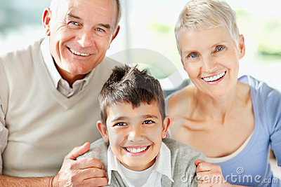 Happy grandparents with grandson smiling