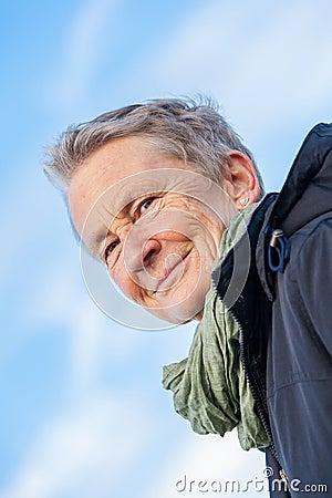 Happy grey-haired elderly woman senior outdoor