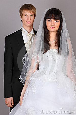 Happy groom and bride in studio