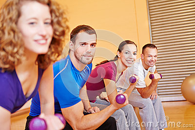 Happy group with dumbbells