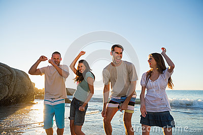Happy group of friends dancing together