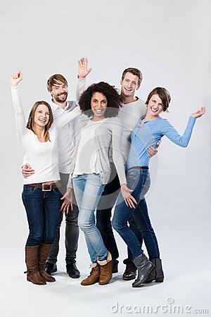 Happy group of friends laughing and waving
