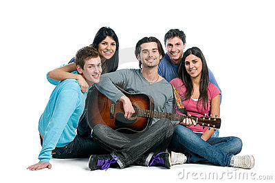 Happy group of friends playing guitar