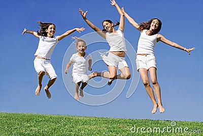 Happy group jumping at summer camp
