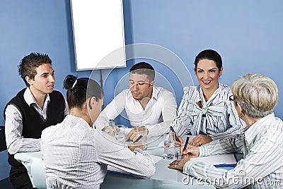 Happy group of people having conversation