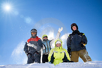The happy group of people throws a snow