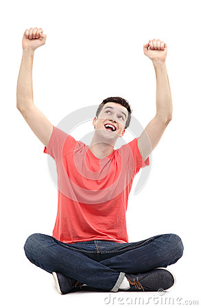 Happy guy with arms raised