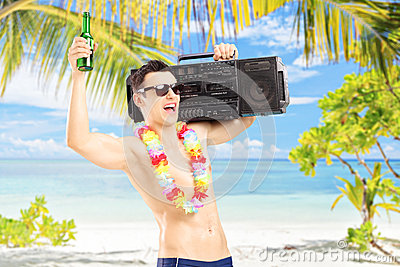 Happy guy with beer and boombox on his shoulder gesturing happin