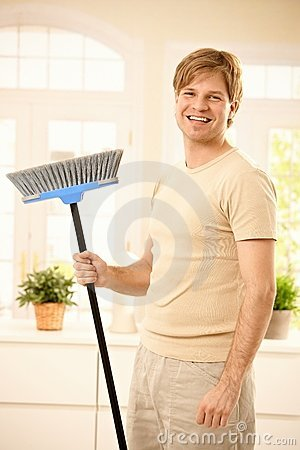 Happy guy with broomstick