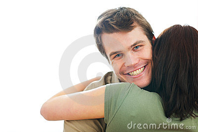 Happy guy hugging girlfriend
