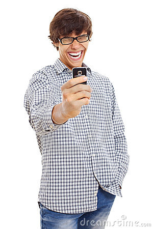 Happy guy making picture by phone