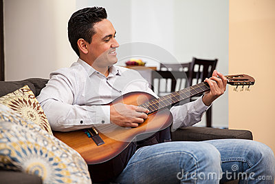 Happy guy playing a guitar