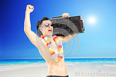 Happy guy with radio on his shoulder gesturing happiness next to