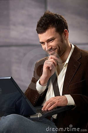 Free Happy Guy Smiling With Laptop Royalty Free Stock Images - 16892179
