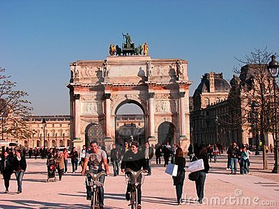 Happy guys on bicycle around Louvre, Paris Editorial Image