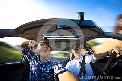 Happy guys in car