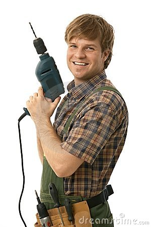 Happy handyman posing with power drill