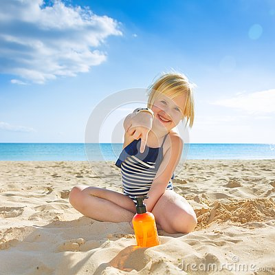 Free Happy Healthy Child In Swimwear On Beach Pointing At Sun Screen Stock Images - 93877884